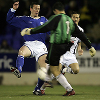 St Johnstone v St Mirren..18.12.04<br />Chris Hay is denied by St Mirren keeper Craig Hinchcliffe<br /><br />Picture by Graeme Hart.<br />Copyright Perthshire Picture Agency<br />Tel: 01738 623350  Mobile: 07990 594431