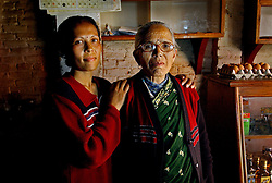 Durga K.C., whose husband has disappeared stands with her mother in law Pabitra K.C. in a coffee shop in Kathmandu, Nepal March 6, 2005.   Her husband is a journalist and like all journalists living in Nepal, tread a very fine line in reporting and remaining free intellectually from both the government and the Maoists.  The Maoist insurgency has claimed over 11,000 lives since 1996. (Ami Vitale)