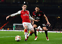 Football - 2017 / 2018 UEFA Europa League - Round of Sixteen, Second Leg: Arsenal (2) vs. AC Milan (0)<br /> <br /> Arsenal's Hector Bellerin holds off the challenge from AC Milan's Hakan Calhanoglu<br /> <br /> COLORSPORT/ASHLEY WESTERN
