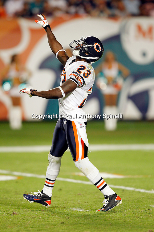 Chicago Bears punt returner Devin Hester (23) waives his arms signaling a fair catch on a punt during the NFL week 11 football game against the Miami Dolphins on Thursday, November 18, 2010 in Miami Gardens, Florida. The Bears won the game 16-0. (©Paul Anthony Spinelli)