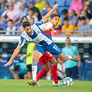 BARCELONA, SPAIN - August 18:  Didac Vila #17 of Espanyol defended by Oliver Torres #21 of Sevilla and Fernando #25 of Sevilla during the Espanyol V  Sevilla FC, La Liga regular season match at RCDE Stadium on August 18th 2019 in Barcelona, Spain. (Photo by Tim Clayton/Corbis via Getty Images)