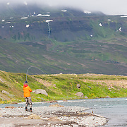 Jökull Bergmann fly fishing at the river Skíðadalsá, North Iceland.