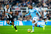 Raheem Sterling (#7) of Manchester City dribbles the ball into the attacking ahlf during the Premier League match between Newcastle United and Manchester City at St. James's Park, Newcastle, England on 30 November 2019.