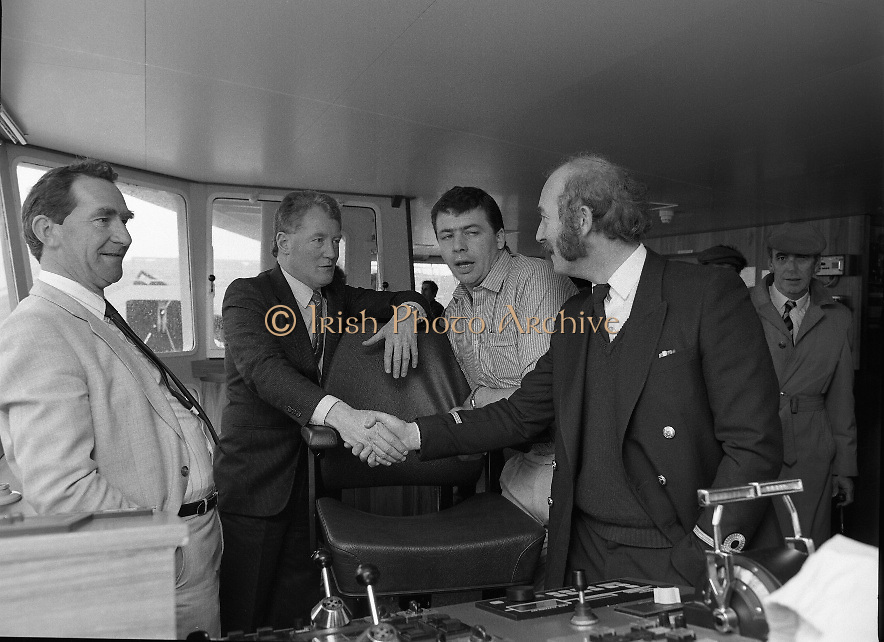 """Supertrawler arrives at Killybegs..1986..17.05.1986..05.17.1986..17th May 1986..""""Atlantic Challenge"""" the new IR£6million supertrawler,the flag ship of the Irish fishing fleet arrived at Killybegs today. The vessel was built for Killybegs' Enterprises in Bergen,Norway. Killybegs' Enterprises also have """"Western Viking"""".""""Jasper Sea"""" and""""Silver King""""supertrawlers in their fleet..The vessel will be skippered by Mr Martin Howley who originally trained with B.I.M.s National Fishery Training Centre, Greencastle..The company plans to fish for non-quota stocks such as Blue Whiting and Horse Mackerel,her fishing pattern will lessen dependence on mackerel as quotas are low for the Irish fleet...Image of a port official congratulating Co Directors of Killybegs'Enterprises, Mr Seamus Tully and Skipper,Mr Martin Howley on the aquisition of their new super trawler. Looking on is Mr Joey Murrin,Chairman,Bord Iascaigh Mhara."""