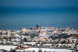 © Licensed to London News Pictures. 27/02/2018. Whitby UK. Whitby Abbey stands on the headland in the seaside town of Whitby in Yorkshire which has seen snow today for the first time since 2010. Photo credit: Andrew McCaren/LNP