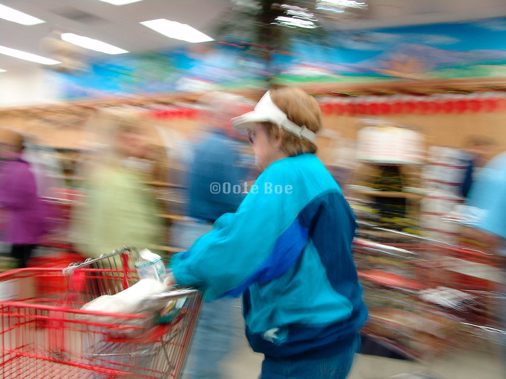Woman in a grocery store rushing to the cashier.