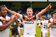 Bradford Bulls replacement Mikolaj Oledzki (31)  celebrates with the fans during the Kingstone Press Championship match between Swinton Lions and Bradford Bulls at the Willows, Salford, United Kingdom on 20 August 2017. Photo by Simon Davies.