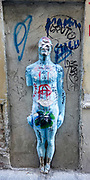 Street sculpture of Adam in blue