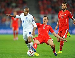 England's Fabian Delph (Aston Villa) battles for the ball with Switzerland's Stephan Lichtsteiner - Photo mandatory by-line: Joe Meredith/JMP - Mobile: 07966 386802 - 08/09/14 - SPORT - FOOTBALL - Switzerland - Basel - St Jacob Park - Switzerland v England - Uefa Euro 2016 Group E Qualifier