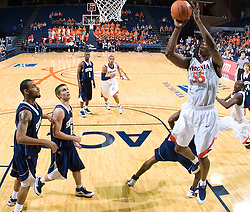 Virginia forward/center Jerome Meyinsse (55) shoots a jump shot.  The Virginia Cavaliers defeated the Shepherd Rams 87-52 in an NCAA basketball exhibition game at the University of Virginia's John Paul Jones Arena in Charlottesville, VA on November 9, 2008.
