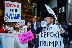 © Licensed to London News Pictures. 07/11/2016. New York CIty, USA. Anti-Trump and pro-Trump activists debate as they campaign outside Trump Tower in New York City on Monday, 7 November, the day before the presidential election day in the United States of America. Photo credit: Tolga Akmen/LNP
