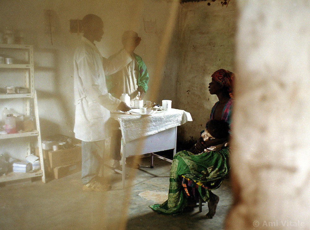 A make-shift hospital in the interior of Angola serves as the only medicine for a society whose brutal 26 year-civil has displaced around two million people. Angola's brutal 26 year-civil has displaced around two million people - about a sixth of the population - and 200 die each day according to United Nations estimates. .(Photo by Ami Vitale)