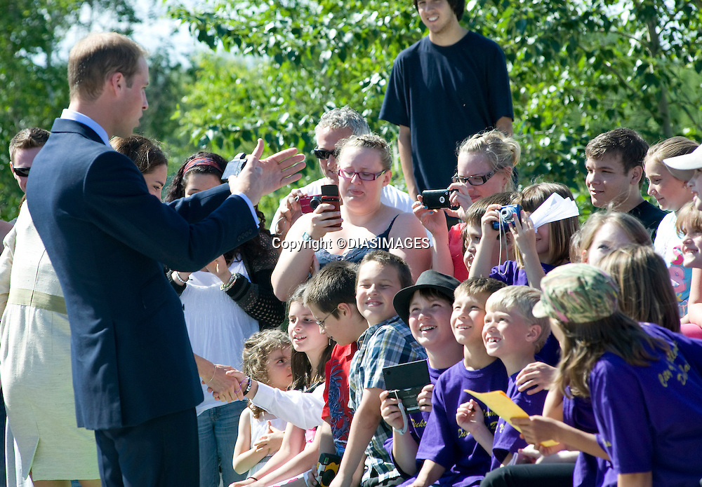 """PRINCE WILLIAM & KATE.official welcome to Yellowknife in the North West Terrorities on the 6th day of their Canadian Royal Tour.The Royal Couple observed a number of traditional activities at Somba K'e Civic Plaza, with .Prince William also participating in a street hockey penalty shoot-out, Yellowknife_05/07/2011.Mandatory Credit Photo: ©DIAS-DIASIMAGES..**ALL FEES PAYABLE TO: """"NEWSPIX INTERNATIONAL""""**..IMMEDIATE CONFIRMATION OF USAGE REQUIRED:.DiasImages, 31a Chinnery Hill, Bishop's Stortford, ENGLAND CM23 3PS.Tel:+441279 324672  ; Fax: +441279656877.Mobile:  07775681153.e-mail: info@newspixinternational.co.uk"""