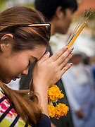 29 DECEMBER 2013 - BANGKOK, THAILAND: A person prays for the Patriarch at Wat Bowon Niwet in Bangkok. Somdet Phra Nyanasamvara, who headed Thailand's order of Buddhist monks for more than two decades and was known as the Supreme Patriarch, died Oct. 24 at a hospital in Bangkok. He was 100. He was ordained as a Buddhist monk in 1933 and rose through the monastic ranks to become the Supreme Patriarch in 1989. He was the spiritual advisor to Bhumibol Adulyadej, the King of Thailand when the King served as monk in 1956. There is a 100 day mourning period for the Patriarch. Although the Patriarch was a Theravada Buddhist, he was the Supreme Patriarch of all Buddhists in Thailand, including the Mahayana sect, which is based on Chinese Buddhism.       PHOTO BY JACK KURTZ