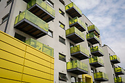 Yellow balconies and fencing of flats along Colharbour Lane in Camberwell, on 5th July 2018, in London, England.