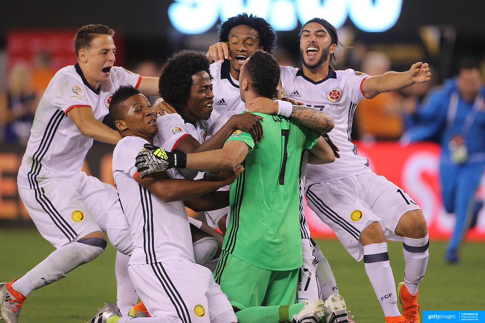 EAST RUTHERFORD, NEW JERSEY - JUNE 17:  David Ospina #1 of Colombia is mobbed by team mates after making the final save for Colombia to win the penalty shoot out during the Colombia Vs Peru Quarterfinal match of the Copa America Centenario USA 2016 Tournament at MetLife Stadium on June 17, 2016 in East Rutherford, New Jersey. (Photo by Tim Clayton/Corbis via Getty Images)