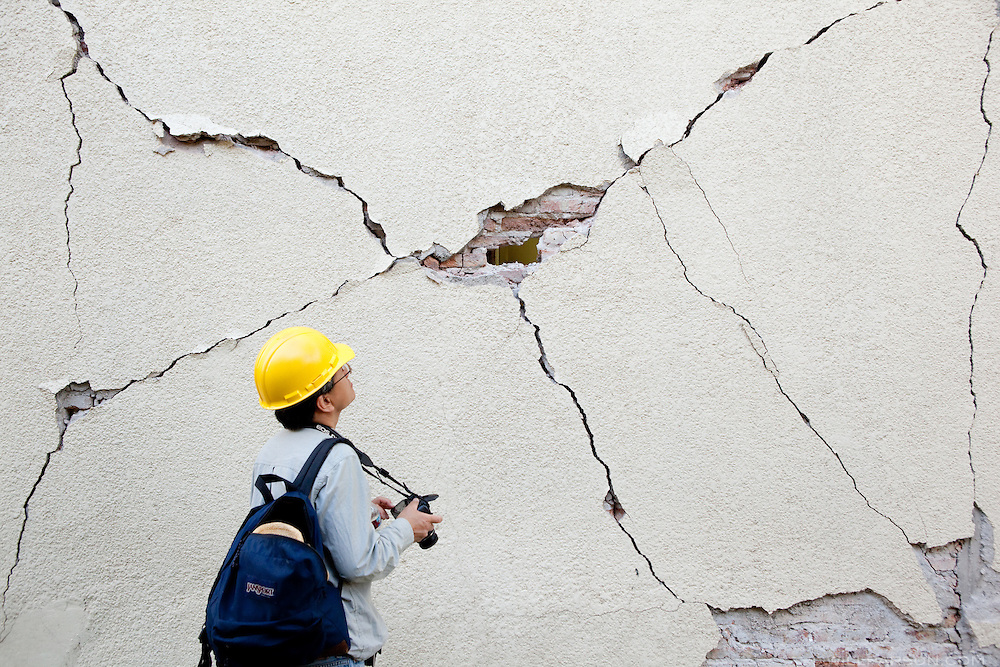 Dr. Benson Shing examines a large crack in a wall on the campus of the Universidad Autónoma de Baja California. A group of researchers led by Dr. Shing, Vice Chair of the Department of Structural Engineering at the University of California, San Diego, inspected the earthquake damage in Mexicali, Mexico, April 7, 2010. A 7.2 magnitude earthquake in Baja California on Easter Sunday was felt as far away as Los Angeles.