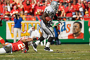 Oakland Raider running back jumps to avoid Kansas City Chiefs defensive back Sammy Knight during a 27 to 23 loss to the Kansas City Chiefs on November 6, 2005 at Arrowhead Stadium in Kansas City, Missouri.