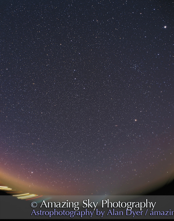 Spring Sky panorama -- sky rising, facing east in early evening April, 2004. Jupiter is at upper right in Leo.<br /> <br /> Shows Dipper pointing to Polaris and Little Dipper and down to Arcturus. Come Berenices cluster visible at upper right. <br /> <br /> Taken with Pentax 6x7 camera with 35mm wide-angle fish-eye lens from hom April 10, 2004. Fujichrome 400F 120-format film (very fined grained for 400 speed film). 35 minute exposure at f/5. Tracked but not guided. Slight aurora adds purple yellow glow at lower left to NE horizon.<br /> <br /> Glow layer added in Photoshop to fuzz stars.