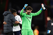 Alisson Becker (1) of Liverpool celebrates the 3-0 win at full time during the Premier League match between Bournemouth and Liverpool at the Vitality Stadium, Bournemouth, England on 7 December 2019.