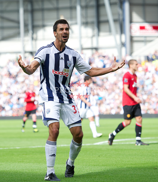 WEST BROMWICH, ENGLAND - Sunday, August 14, 2011: West Bromwich Albion's Paul Scharner urges his supporters to get behind the team during the Premiership match against Manchester United at the Hawthorns. (Pic by David Rawcliffe/Propaganda)