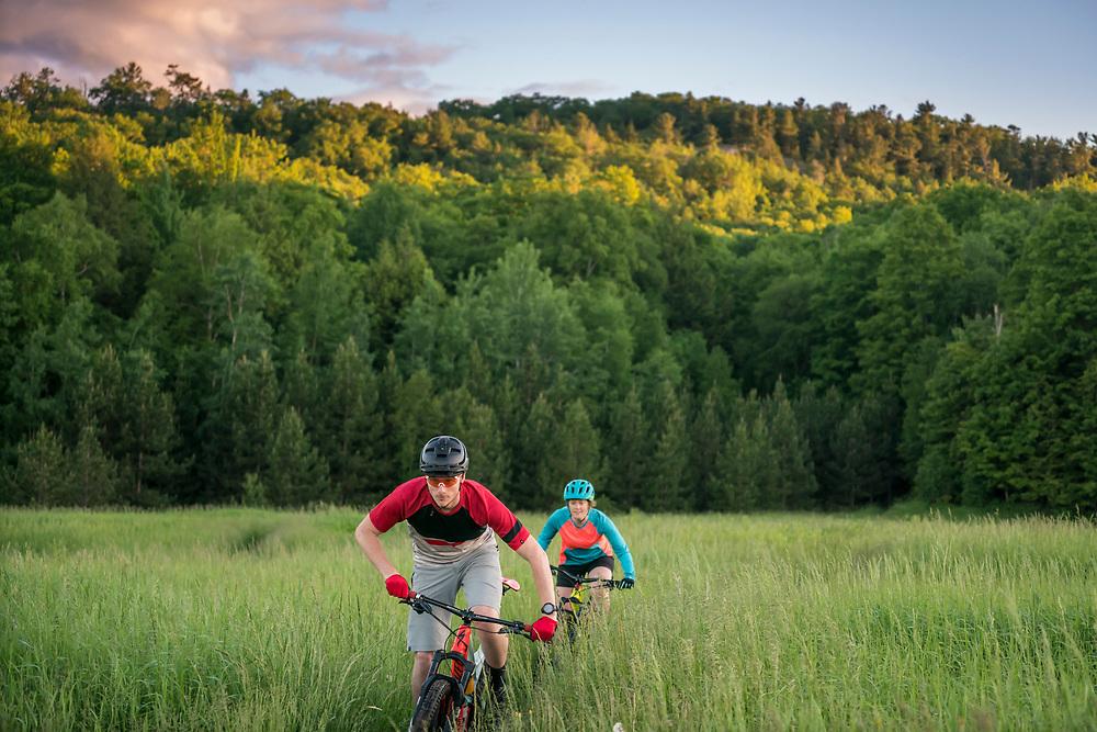 Mountain biking on the Noquemanon Trails Network South Trails in Marquette, Michigan.