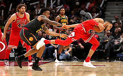 October 26, 2017 - Chicago, IL, USA - The Chicago Bulls' Denzel Valentine (45) secures a loose ball in front of the Atlanta Hawks' John Collins (20) in the second half at the United Center in Chicago on Thursday, Oct. 26, 2017. The Bulls won, 91-86. (Credit Image: © Chris Sweda/TNS via ZUMA Wire)
