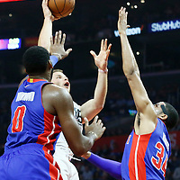 07 November 2016: Los Angeles Clippers forward Blake Griffin (32) goes for the baby hook over Detroit Pistons center Andre Drummond (0) and Detroit Pistons forward Tobias Harris (34) during the LA Clippers 114-82 victory over the Detroit Pistons, at the Staples Center, Los Angeles, California, USA.
