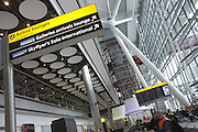 Looking upwards in landside Departures area newly-opened London Heathrow Airport's Terminal 5 building.