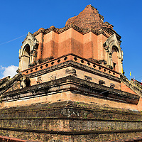 Brick Chedi Ruins at Wat Chedi Luang in Chiang Mai, Thailand <br /> Construction of this enormous brick chedi began in 1391. It was the tallest building in the Kingdom of Lanna upon completion in 1475. This religious landmark was partially destroyed during an earthquake in 1545 and then fell to the Toungoo Empire a few years later. That Burmese dynasty was once the largest empire in Southeast Asia. Today, this giant stupa at Wat Chedi Luang is in ruins but is still impressive.