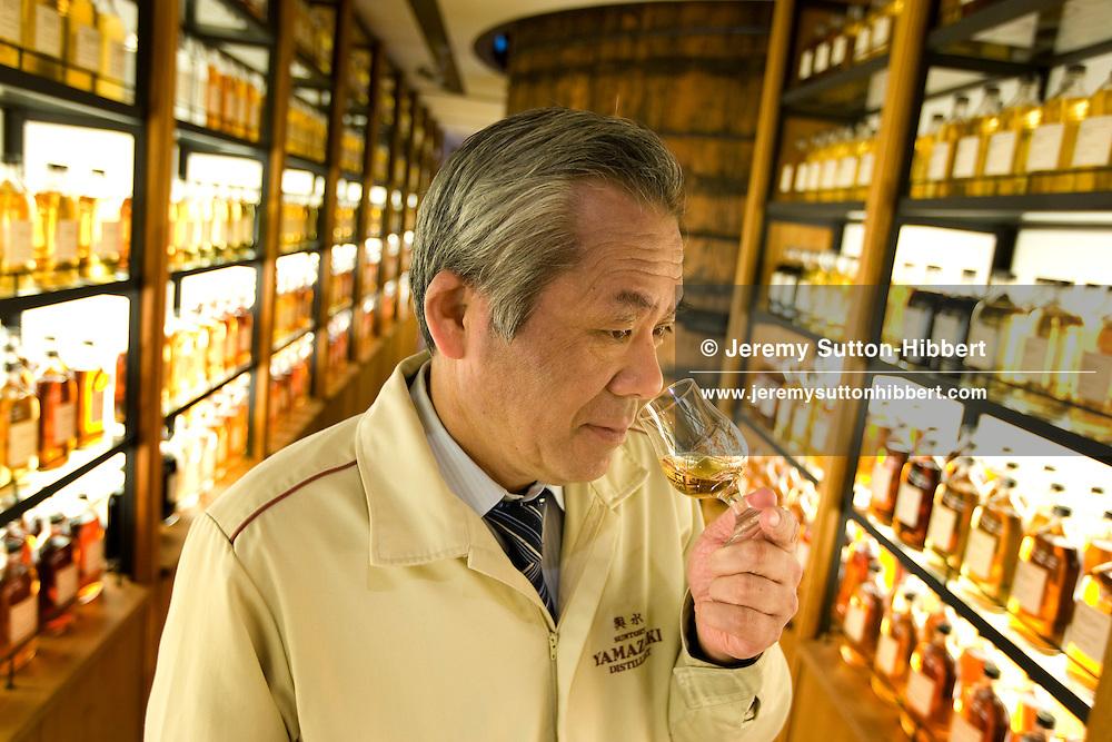 "Seiichi Koshimizu, Suntory whisky Chief Blender ""nosing"" a whisky in the Whisky Library of the Suntory Yamazaki distillery, Yamazaki, Japan. Friday 3rd April 2009."