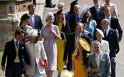 Amal Clooney and George Clooney (front right) arrive at St George's Chapel at Windsor Castle for the wedding of Prince Harry and Meghan Markle.