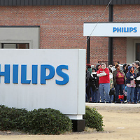 Adam Robison | BUY AT PHOTOS.DJOURNAL.COM<br /> Employees at Philips Day Brite wait outside during a bomb threat to the factory Friday morning in Tupelo.