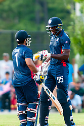 September 22, 2018 - Morrisville, North Carolina, US - Sept. 22, 2018 - Morrisville N.C., USA - Team USA SUNNY SOHAL (1) and ELMORE HUTCHINSON (55) bump fists  during the ICC World T20 America's ''A'' Qualifier cricket match between USA and Canada. Both teams played to a 140/8 tie with Canada winning the Super Over for the overall win. In addition to USA and Canada, the ICC World T20 America's ''A'' Qualifier also features Belize and Panama in the six-day tournament that ends Sept. 26. (Credit Image: © Timothy L. Hale/ZUMA Wire)