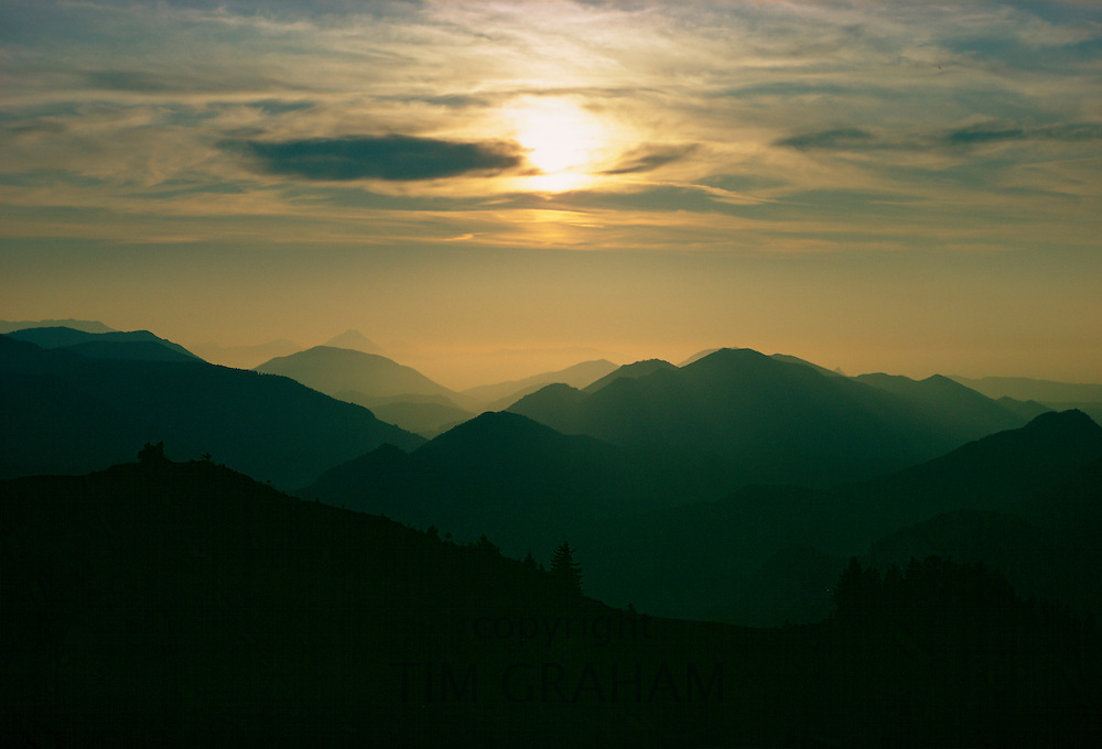 The sun setting over theSalzkammergut mountain range, Austria