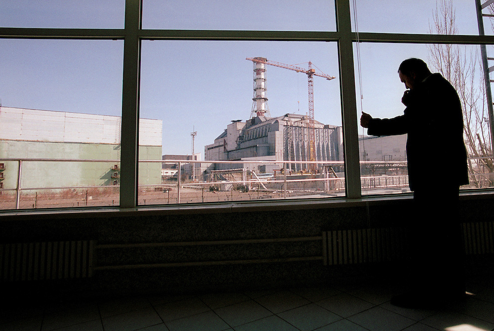 Ukraine 2001..A house with a view over the burnt out nuclear reactor in Chernobyl, now covered by a concrete sarcophagos, has been erected right next to the reactor...Photo: Markus Marcetic/MOMENT