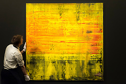 © Licensed to London News Pictures. 01/03/2019. LONDON, UK. A technician examines ''Abstraktes Bild'', 2009, by Gerhard Richter, (Est. £6,000,000 - 8,000,000). Preview of Sotheby's Contemporary Art Sale in their New Bond Street galleries.  Works by artists including Tracey Emin, Jenny Saville, Jean-Michel Basquiat and Andy Warhol will be offered for auction on 5 March 2019.  Photo credit: Stephen Chung/LNP
