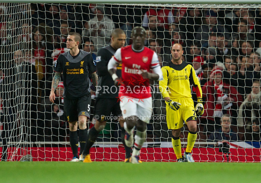 LONDON, ENGLAND - Wednesday, January 30, 2013: Liverpool's goalkeeper Jose Reina looks dejected as Arsenal score the first goal during the Premiership match at the Emirates Stadium. (Pic by David Rawcliffe/Propaganda)