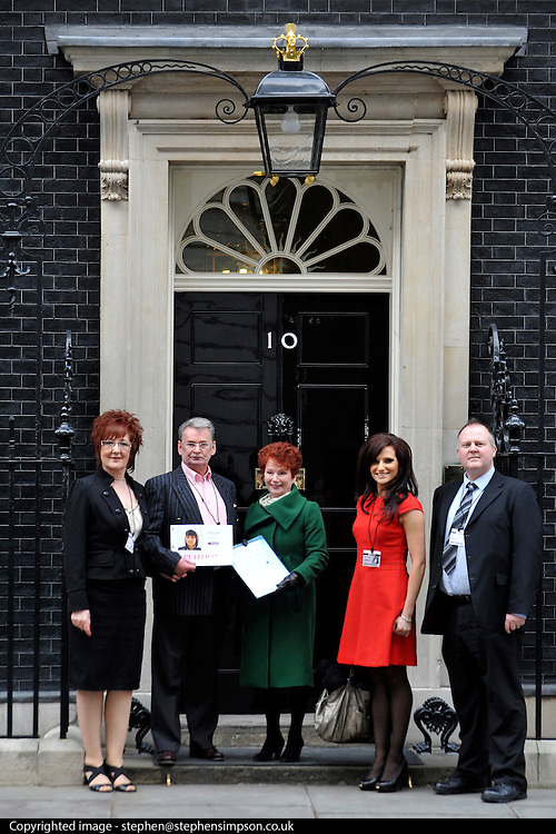 © Licensed to London News Pictures. 20/02/2012, London, UK. LEFT TO RIGHT Elizabeth Betts (partner), Michael Brown (father), Hazel Biers MP, Michelle Livesey (Key 103) and Adam Brown_wilkinson (brother). Clare's Law petition handed to Number 10. Scotsman Michael Brown, father of murdered Clare Wood, hands over petition at Downing Street calling for law change giving women the right to know if their partner has a history of domestic abuse. In 2009 Clare Wood was murdered by her former partner in Salford following months of harassment. Photo credit : Stephen Simpson/LNP