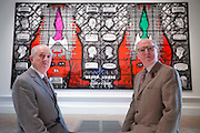 "UNITED KINGDOM, London: 07 June 2016 Gilbert & George (left and right respectively) sit in front of their major new picture ""Beard Aware"" (2016) which will be on display at the Royal Academy of Arts as part of the Royal Academy's 248th Summer Exhibition. Rick Findler / Story Picture Agency"