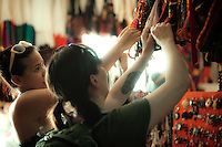 Women shop for locally-made tourist items in Placencia, Belize. Copyright 2014 Reid McNally.