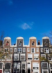 Historic old Dutch houses along Prinsegracht Canal in Amsterdam Netherlands