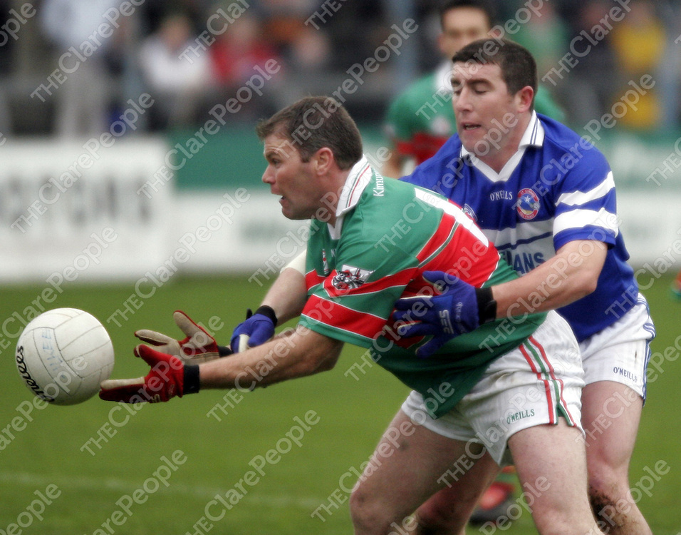 Kilmurry Ibrickane's John O' Connor gets the ball away before Kilkee's Michael Galvin can gain posession during the county football final in Cusack Park on Sunday.<br /> <br /> Photograph by Yvonne Vaughan.