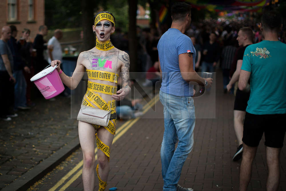 © Licensed to London News Pictures . 26/08/2016 . Manchester , UK . Revellers on Canal Street in Manchcester's Gay Village for 2016 Manchester Gay Pride Big Weekend . Photo credit : Joel Goodman/LNP