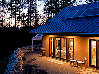 A solar home on Saltspring Island built by NZ Builders operates independantly from the energy grid, using active and passive solar energy, collecting water from the roof and built using concrete insulated panels.