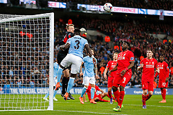 Simon Mignolet of Liverpool punches clear from Bacary Sagna of Manchester City - Mandatory byline: Rogan Thomson/JMP - 28/02/2016 - FOOTBALL - Wembley Stadium - London, England - Liverpool v Manchester City - Capital One Cup Final.
