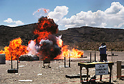Gun range: Explosion at live fire weapons demo.  Soldier of Fortune Convention, Las Vegas, Nevada, USA.