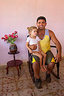 Man with daughter in Cabot Cruz, Granma, Cuba.