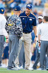 Sep 5, 2015; Morgantown, WV, USA; Georgia Southern Eagles head coach Willie Fritz speaks with West Virginia Mountaineers assistant coach Tony Gibson prior to their game at Milan Puskar Stadium.  Mandatory Credit: Ben Queen-USA TODAY Sports
