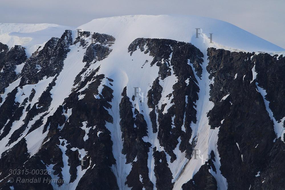 Glacier crowns mountain in Smeerenburgfjorden on the north coast of Spitsbergen island; Svalbard, Norway.